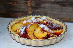 Sliced peach tart. Closeup of summer peach tart with vanilla Royalty Free Stock Photos