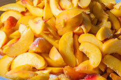Sliced peaches in syrup. Cooking of peach jam or Royalty Free Stock Photos