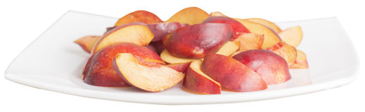 Sliced peaches in a white dish Royalty Free Stock Photos