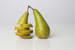 Sliced pear and whole pear. Sliced pear next to a whole pear Royalty Free Stock Photo
