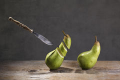 Sliced Pears and flying Knife Stock Photo