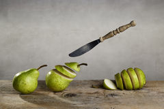 Sliced Pears and flying Knife Stock Image