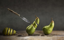 Sliced Pears and flying Knife Stock Photos