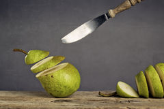 Sliced Pears and flying Knife Royalty Free Stock Images