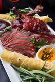 Sliced peking duck. Served with sauces and vegetables Royalty Free Stock Photography