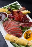 Sliced peking duck. Served with sauces and vegetables Stock Photography
