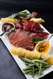 Sliced peking duck. Served with sauces and vegetables Stock Image