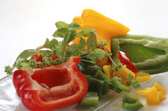 Sliced pepper with herbs Stock Photo