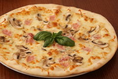 Sliced Pepperoni, Ham and Mushrooms Pizza Royalty Free Stock Photography