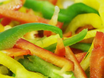 Sliced peppers #2. Sliced green, red and yellow sweet peppers Royalty Free Stock Photo