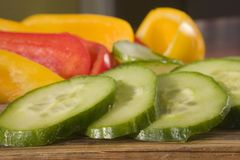 Sliced peppers and cucumber Royalty Free Stock Photos