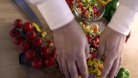 Sliced peppers to flavor pasta stock video footage