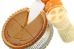 Sliced pie with cup of eggnog. Sliced up Pumpkin Pie with cup of eggnog with nutmeg sprinkled on top Stock Images