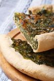 Sliced pie with spinach and soft cheese vertical Stock Images