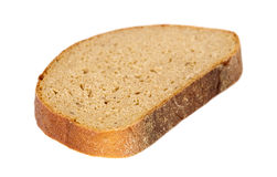 Sliced pieace of dark bread Royalty Free Stock Images