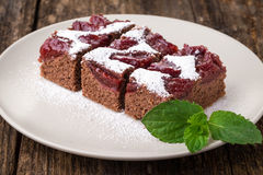 sliced piece of plum cake with cocoa Stock Images