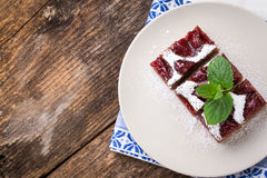 sliced piece of plum cake with cocoa Royalty Free Stock Photography