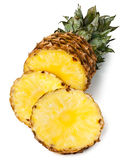 Sliced pineapple. Against white background Royalty Free Stock Photography