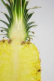 Sliced pineapple. Vertical section through pineapple - fruit offset from center of frame Royalty Free Stock Photos