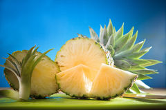 Sliced of pineapple on blue blackground Royalty Free Stock Photo