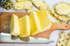 Sliced pineapple fruit on a board Royalty Free Stock Photos