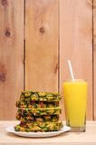 Sliced pineapple and juice Royalty Free Stock Photos