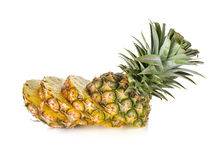Sliced pineapple with leaves on white Stock Photography