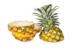Sliced pineapple with leaves on white Stock Image