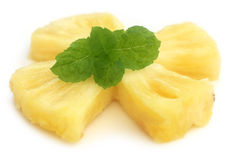 Sliced pineapple with mint leaves Stock Photo
