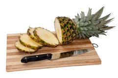 Sliced pineapple pieces on a wooden board Royalty Free Stock Image