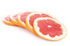 Sliced pink grapefruit isolated royalty free stock photos