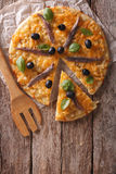 Sliced pizza with anchovies and onions. vertical top view Royalty Free Stock Photos