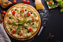 Chicken pizza. Sliced pizza are on the chalk board Royalty Free Stock Images