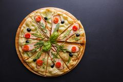 Chicken pizza. Sliced pizza are on the chalk board Royalty Free Stock Photo