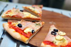Sliced pizza with ham and olives Stock Image