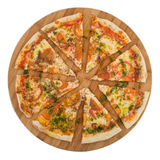 Sliced pizza margarita on wooden board. Isolated on white background. Clipping path Stock Photo