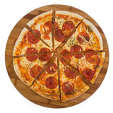 Sliced pizza pepperoni on wooden board. Isolated on white background. Clipping path Royalty Free Stock Photo