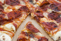 Sliced pizza pie. A closeup on a sliced peperoni pizza pie Stock Images