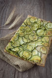 Sliced pizza with zucchini Stock Photo