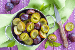 Sliced plums. On a plate Royalty Free Stock Image