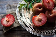 Sliced Plums on Silver Round Platter Stock Images