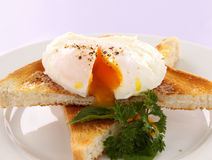 Sliced Poached Egg. Delicious sliced poached egg sprinkled with cracked pepper Stock Images