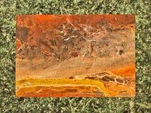 Sliced polished stone. In  stone frame Stock Image