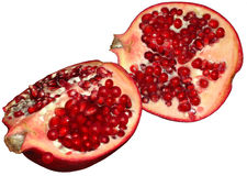 Sliced Pomegranate or Chinese Apple. Pomegranate cut open to reveal a multitude of bright ruby red seeds nesting in milky white membrane or pulp. Punica granatum Stock Image