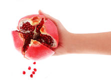 Sliced pomegranate in hand and seeds Stock Images