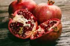 Sliced pomegranate and raw pomegranate Royalty Free Stock Photos