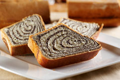 Sliced poppy seed cake Royalty Free Stock Photo