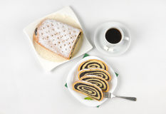 Sliced poppy seed roll and cup of coffee Royalty Free Stock Photo