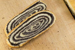 Sliced poppy seed strudel sliced on the wooden table Stock Photo