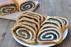 Sliced poppy seed and walnut rolls Royalty Free Stock Photography